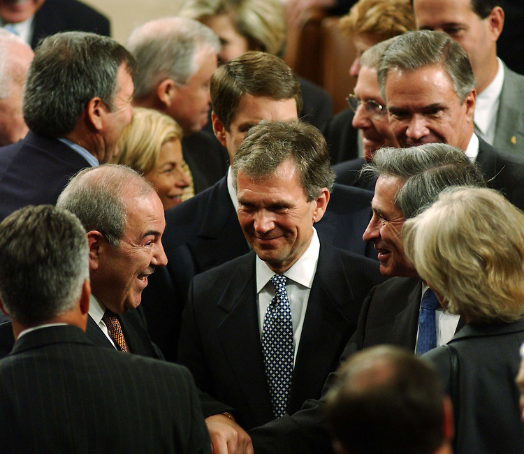 9/23/04.ALLAWI SPEECH--Iraqi Interim Prime Minister Ayad Allawi and Deputy Defense Secretary Paul D. Wolfowitz greet each other as after Allawi's address to a joint meeting of the House and Senate. He is trailed by Senate Majority Leader Bill Frist, R-Tenn., middle and obscured, and Senate Minority Leader Tom Daschle, D-S.D., middle..CONGRESSIONAL QUARTERLY PHOTO BY SCOTT J. FERRELL