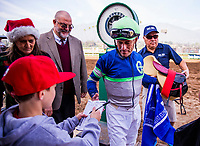 ARCADIA, CA - DECEMBER 26: Jockey Gary Stevens signs an autograph for a fan at Santa Anita Park on December 26, 2017 in Arcadia, California. (Photo by Alex Evers/Eclipse Sportswire/Getty Images)