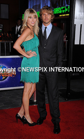 "SARAH WRIGHT AND ERIC CHRISTIAN OLSEN.attends the World Premiere of ""The Thing"" at Universal Studios Hollywood AMC CityWalk Stadium 19 Theatre's, Universal City, California_10/10/2011.Mandatory Photo Credit: ©Crosby/Newspix International. .**ALL FEES PAYABLE TO: ""NEWSPIX INTERNATIONAL""**..PHOTO CREDIT MANDATORY!!: NEWSPIX INTERNATIONAL(Failure to credit will incur a surcharge of 100% of reproduction fees).IMMEDIATE CONFIRMATION OF USAGE REQUIRED:.Newspix International, 31 Chinnery Hill, Bishop's Stortford, ENGLAND CM23 3PS.Tel:+441279 324672  ; Fax: +441279656877.Mobile:  0777568 1153.e-mail: info@newspixinternational.co.uk"