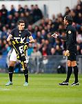 Nederland, Eindhoven, 25 november  2012.Eredivisie.Seizoen 2012-2013.PSV-Vitesse.Jonathan Reis van Vitesse heeft na het scoren van de 1-1 zijn wedstrijd-shirt uitgetrokken, op het shirt wat hij onder zijn wedstrijd-shirt aan heeft staat met grote letters 'JK'. Hij krijgt van scheidsrechter Bas Nijhuis een gele kaart voor zijn actie. .