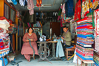 A taylor and his wife in their store on the streets of Thamel, Nepal