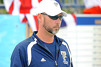 14 January 2012:  FIU Swimming Head Coach Randy Horner watches his swimmers during pre-meet warm-ups.  The FIU Golden Panthers won the meet with the Central Connecticut State University Blue Devils at the Biscayne Bay Campus Aquatics Center in Miami, Florida.