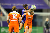 Orlando, Florida - Saturday, April 23, 2016: Houston Dash midfielder Cami Privett (23) and Orlando Pride defender Kristen Edmonds (12) battle for an air ball during an NWSL match between Orlando Pride and Houston Dash at the Orlando Citrus Bowl.