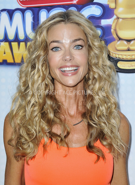 WWW.ACEPIXS.COM....April 27 2013, LA....Actress Denise Richards arriving at the 2013 Radio Disney Music Awards at the Nokia Theatre L.A. Live on April 27, 2013 in Los Angeles, California...........By Line: Peter West/ACE Pictures......ACE Pictures, Inc...tel: 646 769 0430..Email: info@acepixs.com..www.acepixs.com