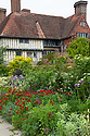 Great Dixter, late May. Looking towards to the eastern end of the house from the Long border.