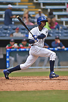 Asheville Tourists right fielder Raimel Tapia #15 swings at a pitch during a game against the Greenville Drive at McCormick Field on May 18, 2014 in Asheville, North Carolina. The Tourists defeated the Drive 3-1. (Tony Farlow/Four Seam Images)