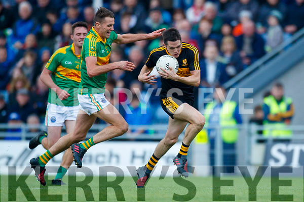 Brian Looney Dr Crokes in action against Brendan O'Sullivan South Kerry in the Senior County Football Final in Austin Stack Park on Sunday