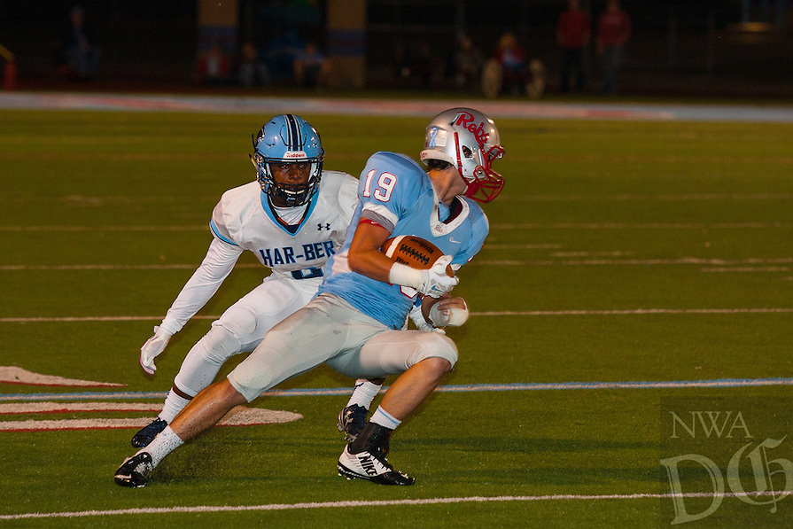 #19 Randy Rainwater of Southside cuts back inside of a Har-Ber defender after a pass receiption during the first half.