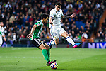 Rafa Navarro of Real Betis competes for the ball with James Rodriguez of Real Madrid  during the match of Spanish La Liga between Real Madrid and Real Betis at  Santiago Bernabeu Stadium in Madrid, Spain. March 12, 2017. (ALTERPHOTOS / Rodrigo Jimenez)