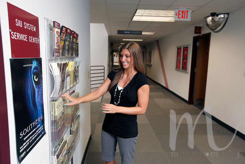 Sarita Robinson, Director of SIU Service Center - Shawnee Community College, adjusts literature outside the SIU Service Center located within Shawnee Community College in Ullin, Ill., on Wednesday, July 13, 2011. Seven SIU Service Centers such as this one have partnered with Illinois state community colleges in a pilot program where students in the program will apply and be accepted at the four-year institution, but complete their first two years at the community college.