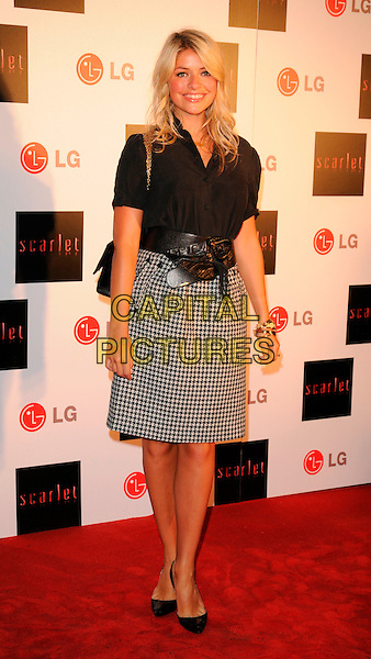 "HOLLY WILLOUGHBY.""Scarlet"" - TV series launch, No. 1 Marylebone, Marylebone Road, London, England..April 30th, 2008. full length black white shirt skirt pattern print dogtooth bracelets.CAP/CAN.©Can Nguyen/Capital Pictures."