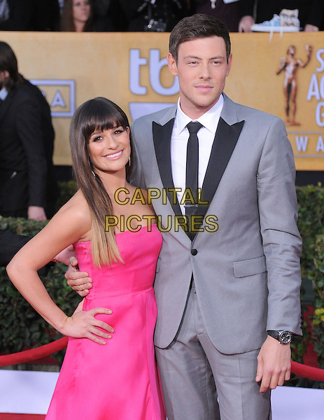 Lea Michele (wearing Valentino) & Corey Monteith.Arrivals at the 19th Annual Screen Actors Guild Awards at the Shrine Auditorium in Los Angeles, California, USA..27th January 2013.SAG SAGs half length pink strapless dress hand on hip grey gray suit black lapels tie white shirt.CAP/DVS.©DVS/Capital Pictures.