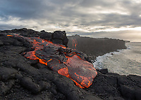 Pele to Meet Namaka: At sunrise, the fire goddess Pele in the form of lava is poised at the edge of a cliff, about to meet her sister, water goddess Namaka in the form of the ocean, 61g flow, Kamokuna Ocean entry, Big Island. Lava falls off the cliff's edge, eventually forming a new lava bench or delta, an incredibly rare sight.