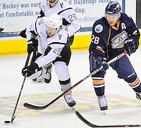 San Antonio Rampage's James Wright, left, skates ahead of Oklahoms City Barons' Ryan Keller during the second period of an AHL hockey game, Monday, May 7, 2012, in San Antonio. (Darren Abate/pressphotointl.com)