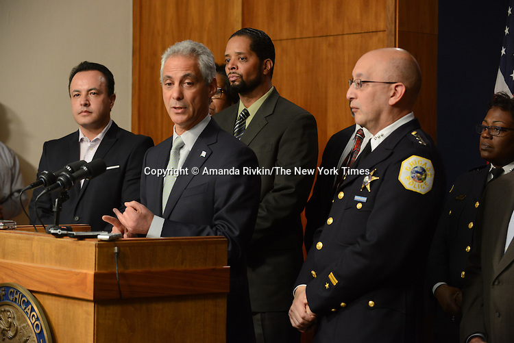 Chicago Mayor Rahm Emanuel during a press conference at Chicago City Hall flanked by Interim Chicago Police Superintendent John Escalante (at right) announcing more Tasers for Chicago police officers and training following a deadly shooting involving Chicago police over the weekend while Mayor Emanuel was on vacation in Cuba in Chicago, Illinois on December 30, 2015.  Over the weekend, Chicago police shot and killed 55 year old Bettie Jones and 19 year old Quintonio LeGrier while responding to a call over a domestic incident.