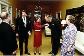 Joseph M.A.H. Luns, Secretary General of the North Atlantic Treaty Organization (NATO), right center, greets first lady Nancy Reagan, center, while United States President Ronald Reagan, left center, welcomes Elisabeth Borgman-Brouwer, Presonal Assistant to Mr. Luns, right, and Paul van Campen, Cabinet Director, left, at the White House in Washington, D.C. on Thursday, April 16, 1981..Mandatory Credit: Michael Evans - White House via CNP
