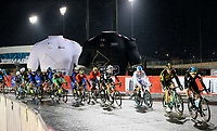 PICTURE BY MARK GREEN/SWPIX.COM ATP  Tour of Abu Dhabi - Yas Island Stage, UAE, 26/02/17<br /> The peleton goes past the giant promotional jerseys at the Yas Marina Circuit. Heavy rain before and during the event made the stage very difficult for the riders.