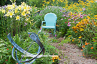 63821-205.14  Garden path with armillary, blue chair and birdhouses.  Yellow Daylillies (Hemerocallis)  Black-eyed Susans (Rudbeckia hirta), Purple Coneflowers (Echinacea purpurea), Gray-headed Coneflowers (Ratibida pinnata) and Pink Bee balm (Monarda fistulosa), Butterfly Milkweed (Asclepias tuberosa)  Marion Co. IL