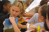 Jennifer O'Sullivan of the New York Power signs autographs for fans following the Power's 2-0 loss to the Atlanta Beat on June 9th at Mitchel Athletic Complex. O'Sullivan has not played this year due to a knee injury.