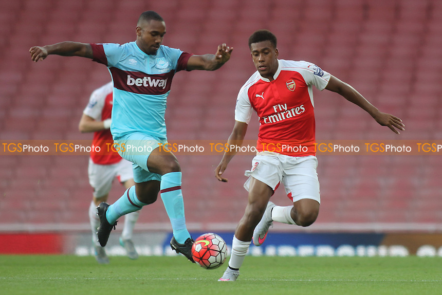 Emmanuel Onariase of West Ham in possession as Arsenal's Alex Iwobi looks on