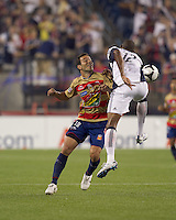 New England Revolution defender Cory Gibbs (12) intercepts pass to Monarcas Morelia forward Luis Gabriel Rey (18). Monarcas Morelia defeated the New England Revolution, 2-1, in the SuperLiga 2010 Final at Gillette Stadium on September 1, 2010.