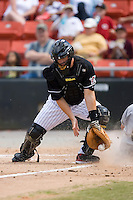 Catcher Andrew Walker (36) of the Hickory Crawdads tries to block a low throw as a Charleston RiverDogs crosses the plate at L.P. Frans Stadium in Hickory, NC, Sunday, May 4, 2008.