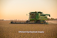 63801-07110 Farmer harvesting soybeans at sunset, Marion Co., IL