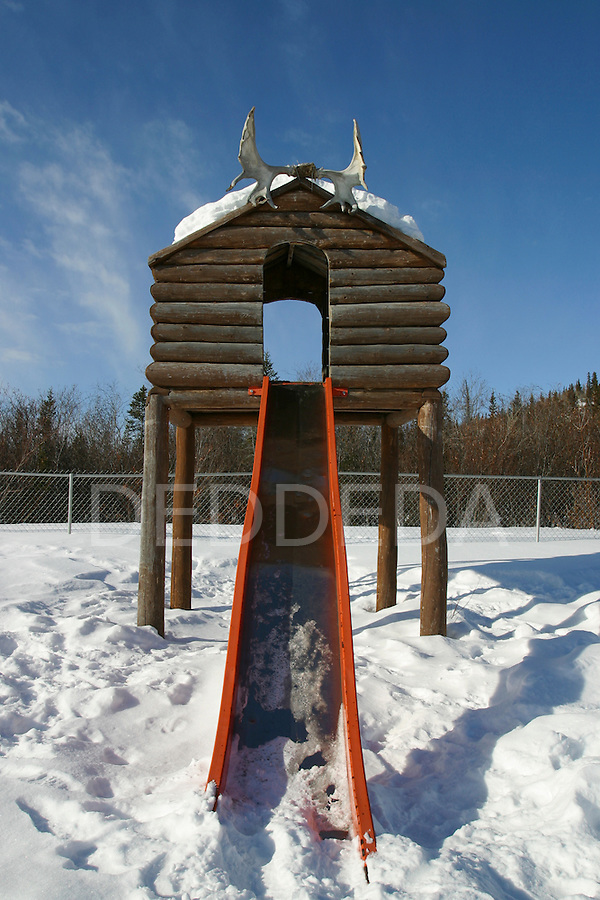 Caribou antlers on a slide in a children's playground in Old Crow, Yukon Territory, Canada.