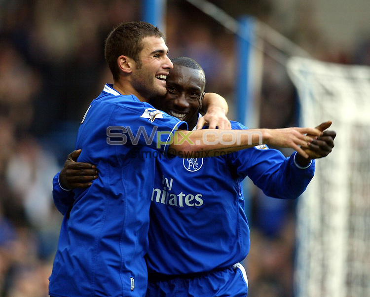 Pix: Rob Matthews/SWpix.com. Soccer. Barclaycard Premiership. Season 2003/2004. Chelsea v Manchester City. 25/10/2003...COPYWRIGHT PICTURE>>SIMON WILKINSON>>01943 608782>>..Adrian Mutu celebrates with Jimmy Floyd Hassellbaink after setting up Hasselbaink's first half goal..