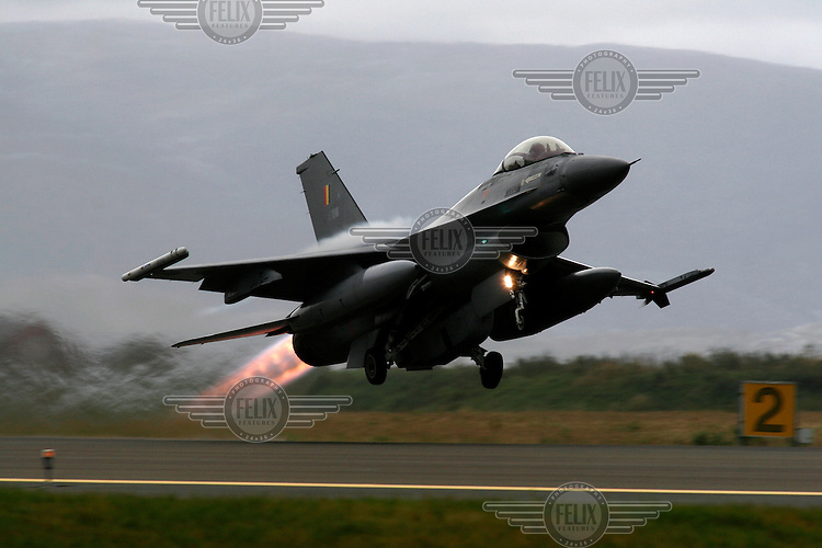 Lockheed Martin F-16 Fighting Falcon from Belgian Air Force 349 squadron taking off with afterburner. BOLD AVENGER 2007 (BAR 07), a NATO  air exercise at Ørland Main Air Station, Norway. BAR 07 involved air forces from 13 NATO member nations: Belgium, Canada, the Czech Republic, France, Germany, Greece, Norway, Poland, Romania, Spain, Turkey, the United Kingdom and the United States of America. The exercise was designed to provide training for units in tactical air operations, involving over 100 aircraft, including combat, tanker and airborne early warning aircraft and about 1,450 personnel.