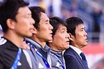Japan Head Coach Hajime Moriyasu (R) and his assistants  listens to the national anthem before the AFC Asian Cup UAE 2019 Quarter Finals match between Vietnam (VIE) and Japan (JPN) at Al Maktoum Stadium on 24 January 2019 in Dubai, United Arab Emirates. Photo by Marcio Rodrigo Machado / Power Sport Images