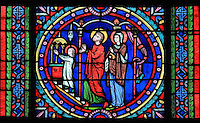 The presentation of Mary in the temple, stained glass window, 1871-75, one of 3 windows by Gsell Laurent Gaspard after drawings by Steinheil Louis, in the apse of the Collegiale Notre-Dame de Poissy, a catholic parish church founded c. 1016 by Robert the Pious and rebuilt 1130-60 in late Romanesque and early Gothic styles, in Poissy, Yvelines, France. The window tells the story of the Life of the Virgin. The Collegiate Church of Our Lady of Poissy was listed as a Historic Monument in 1840. Picture by Manuel Cohen