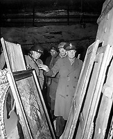 General Dwight D. Eisenhower, Supreme Allied Commander, accompanied by Gen. Omar N. Bradley, and Lt. Gen. George S. Patton, Jr., inspects art treasures stolen by Germans and hildden in salt mine in Germany.  April 12, 1945.  Lt. Moore.  (Army)<br /> NARA FILE #:  111-SC-204516<br /> WAR &amp; CONFLICT BOOK #:  1099