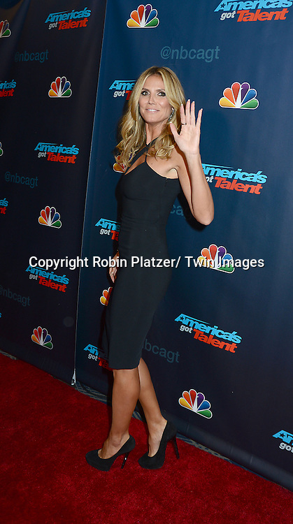 """Heidi Klum in Versace black dress attends the """"America's Got Talent"""" pre show red carpet on September 17, 2013 at Radio City Music Hall in New York City."""