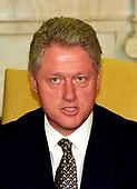 "United States President Bill Clinton meets with reporters in the Oval Office of the White House in Washington, DC to discuss the situation in Iraq following the two strikes by US cruise missiles against Iraqi military targets on September 4, 1996.  The President announced the attacks were successful and said that Iraqi leader Saddam Hussein ""knows there is a price to be paid for stepping over the line.""<br /> Credit: Ron Sachs / CNP"