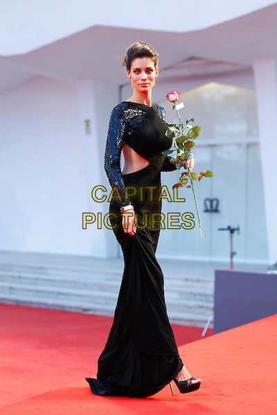 Marica Pellegrinelli.The 'Lines Of Wellington' (Linhas de Wellington) Premiere during The 69th Venice Film Festival at the Palazzo del Cinema, Venice, Italy. .September 4th, 2012 .full length black dress backless rose flower sequins sequined side cut out away sides .CAP/IPP/GR.©Gianluca Rona/IPP/Capital Pictures.