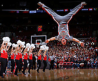 Ohio State University cheerleader Derrick Stouffer, a junior, finishes a series of flips spread-eagled, vertical and upside-down during a time-out at Wednesday's NCAA Division I basketball game pitting the Buckeyes against the American University Eagles at Value City Arena in Columbus on November 20, 2013. Ohio State won the game 63-52. (Barbara J. Perenic/The Columbus Dispatch)