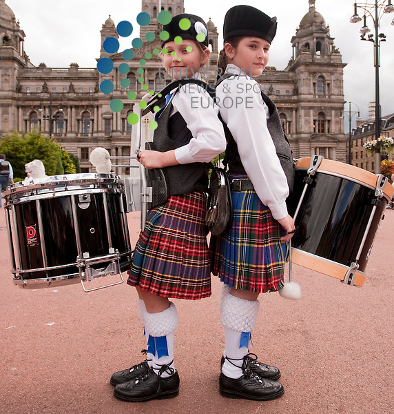 . L-R. Carlize Grace (9) sydney Australia, Caitlyn Ryder (10) Sydey Australia.World Pipe Band Championships curtain-raiser at George Square Glasgow, ahead of the world piping championships at glasgow green on the 14 08 10. . Photo credit Johnny Mclauchlan/Universal News and Sport (Scotland). 13/08/10..