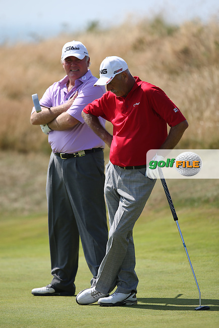 Ronan Rafferty (NIR) and Mark James (ENG) during Round One of the 2014 Senior Open Championship presented by Rolex from Royal Porthcawl Golf Club, Porthcawl, Wales. Picture:  David Lloyd / www.golffile.ie