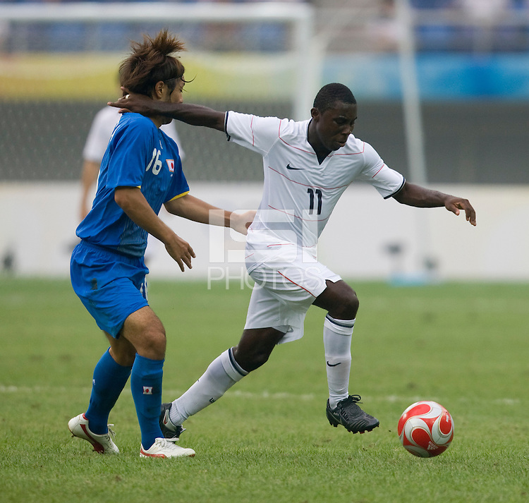 US forward (11) Freddy Adu sprints past Japanese midfielder (16) Takuya Honda at Tianjin Olympic Centre Stadium. The US defeated Japan, 1-0, during first round play in group B at the 2008 Beijing Olympics in Tianjin, China.