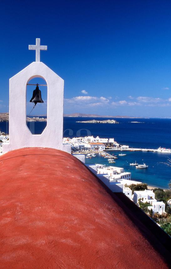 Greece. Mykonos. Greek Orthodox Church and the harbor in Mykonos Town.