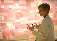 NWA Democrat-Gazette/ANDY SHUPE<br /> Mindy Besaw, Crystal Bridges Curator of American Art, speaks Thursday, Oct. 4, 2018, in front of a piece titled, &quot;Companion Species (Calling All My Relations)&quot; by artist Marie Watt during a tour of a new exhibition of artwork by Native American artists at Crystal Bridges Museum of American Art in Bentonville. The exhibition, titled &quot;Art for a New Understanding: Native Voices, 1950s to Now,&quot; opens today and runs through Jan. 7, 2019.