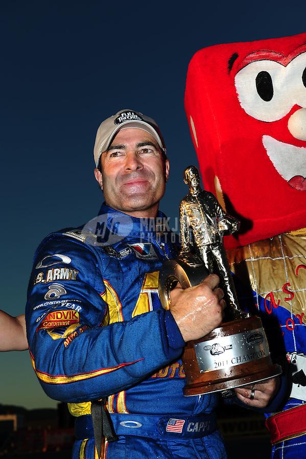 Oct. 30, 2011; Las Vegas, NV, USA: NHRA funny car driver Ron Capps celebrates after winning the Big O Tires Nationals at The Strip at Las Vegas Motor Speedway. Mandatory Credit: Mark J. Rebilas-