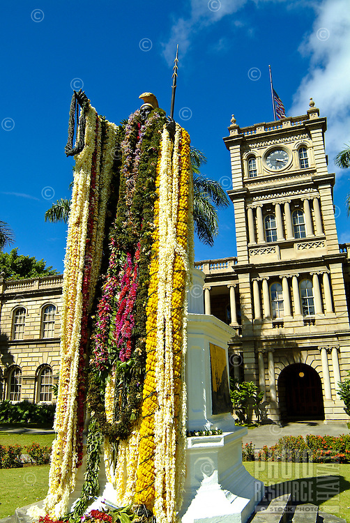 Statue of statesman and monarch King Kamehameha (the ruler who united the Hawaiian Islands) draped with lei in front of the state judiciary building (Ali'Iolani Hale) on King Street in downtown Honolulu, for a festival and parade in honor of his birth