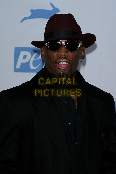 DENIS RODMAN.PETA's 25th Anniversary Gala and Humanitatian Awards Show held at Paramount Pictures, Hollywood,  CA..September 10th, 2005.half length black suit hat sunglasses piercings.Photo credit: Jacqui Wong/AdMedia.www.capitalpictures.com.sales@capitalpictures.com.© Capital Pictures.