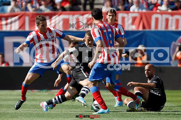 Atletico's Koke (l), Diego Costa (b) Filipe Luis and Granada's Torje during La Liga BBVA match. April 14, 2013.(ALTERPHOTOS/Alconada)