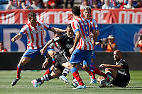 Atletico's Koke (l), Diego Costa (b) Filipe Luis and Granada's Torje during La Liga BBVA match. April 14, 2013.(ALTERPHOTOS/Alconada)