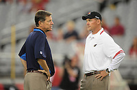Aug. 22, 2009; Glendale, AZ, USA; San Diego Chargers head coach Norv Turner (left) speaks with Arizona Cardinals head coach Ken Whisenhunt prior to the preseason game at University of Phoenix Stadium. Mandatory Credit: Mark J. Rebilas-