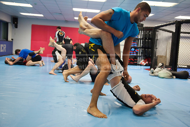 Titan Fighter students practice moves at the gym in Edmonton.  Although some pupils attend the lessons to keep fit, some take part with a view to eventually becoming cage fighters.