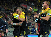 TJ Perenara and Brad Shields (right) congratulate Wes Goosen (left) on his try during the Super Rugby match between the Hurricanes and Crusaders at Westpac Stadium in Wellington, New Zealand on Saturday, 15 July 2017. Photo: Dave Lintott / lintottphoto.co.nz